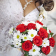 Bride holding beautiful red roses wedding flowers bouquet — Stok fotoğraf