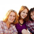 Portrait of three beautiful girls. With counter light on backgro — Stock Photo #3735555