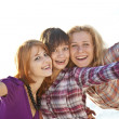 Portrait of three beautiful girls. With counter light on backgro — Stock Photo #3735786