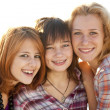 Portrait of three beautiful girls. With counter light on backgro — Stock Photo #3735830