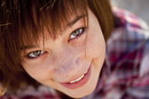 Close-up portrait of beautiful brunet girl. — Stock Photo