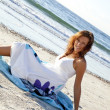 Young girl in sundress on the beach. — Stock Photo #3756367