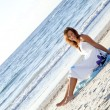 Young girl in sundress on beach. — Stock Photo #3756372