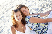 Two beautiful sisters on the beach. — Stock Photo