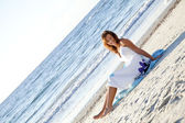 Young girl in sundress on the beach. — Stock Photo