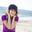 Portrait of red-haired girl with headphone on the beach. — Stock Photo #3790610