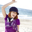 Portrait of red-haired girl with headphone on the beach. — Stock Photo #3790653