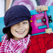 Closeup portrait of a happy young girl with skateboard and graff — Stock Photo #3808142