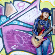Closeup portrait of a happy young girl with guitar and graffiti — Stock Photo #3808168
