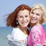 Three girlfriends at the beach. — Stock Photo