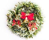Golden Christmas bell on white — Stock Photo