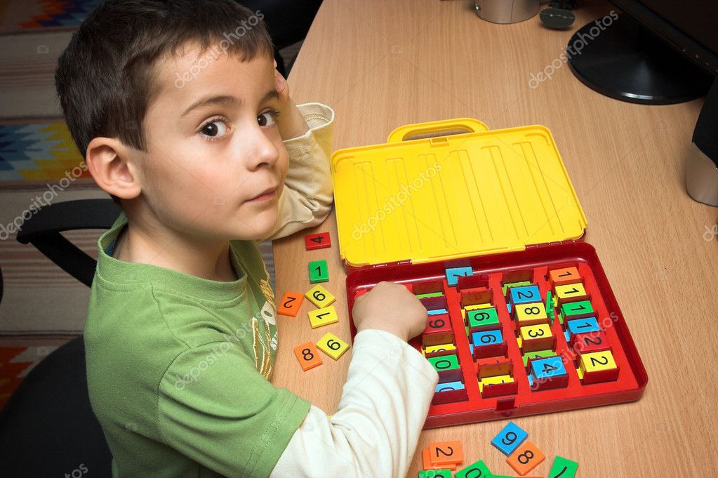 Boy playing with numbers — Stock Photo #3002425