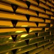 Stock Photo: Wall from gold ingots