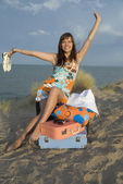 Girl with suitcases — Stock Photo