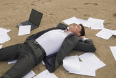 Businessman relax on the beach — Stock Photo