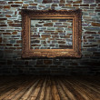 Golden frame on grunge wall — 图库照片