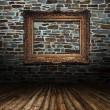 gouden frame op grunge muur — Stockfoto