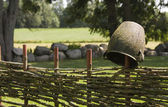 Rural fence with metal pot — Stock Photo