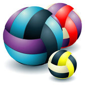 Three voleyballs — Stockvector