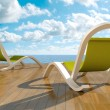Deckchairs in front of sea — Stock Photo