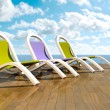 Deckchairs in front of sea — Stock Photo #2977804