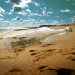 Help message in a bottle - Stock Photo