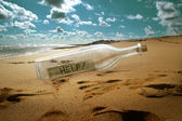 Help message in a bottle — Stockfoto