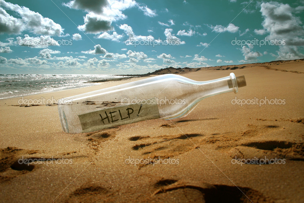 Help message in a bottle on beach — Stock Photo #3452646