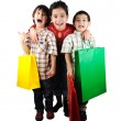 Boy and girl with shopping bag Isolated — Stock Photo
