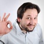 Assertive businessman showing OK sign — Stock Photo #2718915