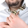 Portrait of an office worker putting his tie — Stock Photo #2718939