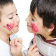 Cute little boy getting make-up on his face — Stock Photo