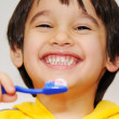 Boy cleans teeths - Stockfoto