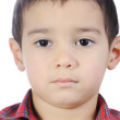 Photo of adorable young boy looking at camera — Stock Photo