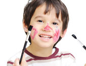 Happy kid with colored heart on his cheek — Stock Photo