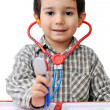 Little young boy doctor over isolated white background - Stock Photo