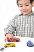 Kid playing with cars — Stock Photo