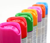 Multicolored aerosol cans — Stock Photo