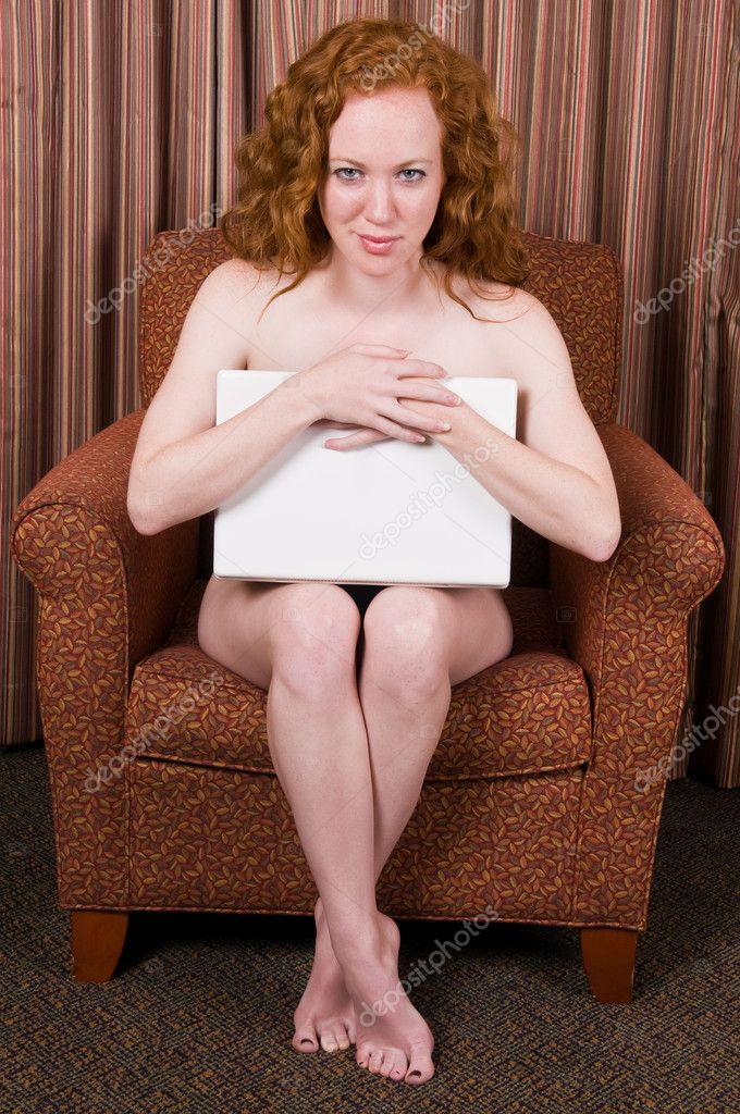 Pretty pale nude redhead with her laptop — Stock Photo #3348365
