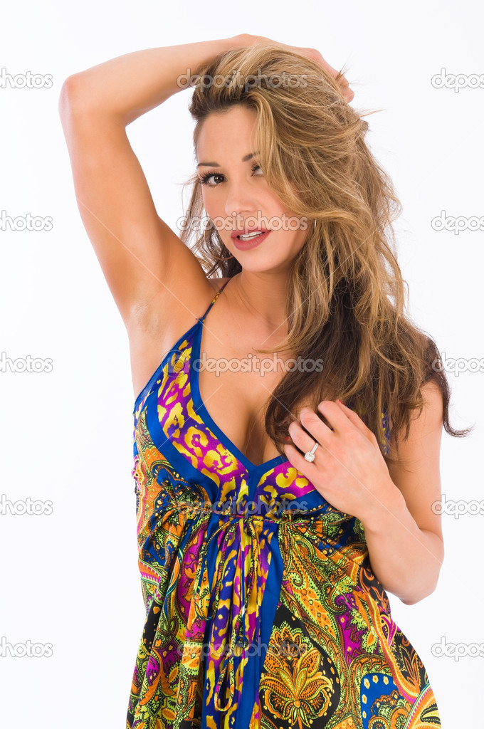 Beautiful young brown haired girl in a long paisley dress — Stock Photo #3942883