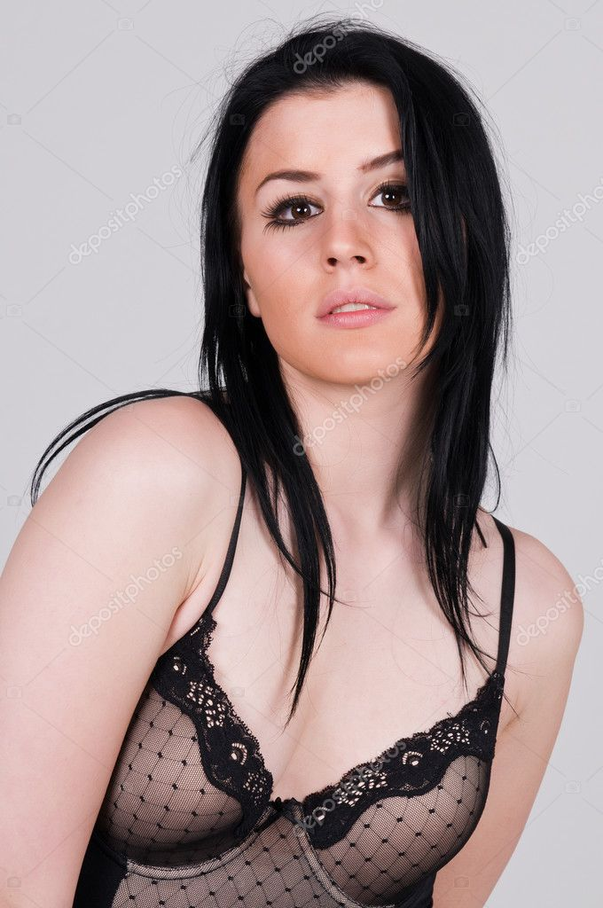 Pretty young brunette in a brown bodysuit  Stock Photo #3980816