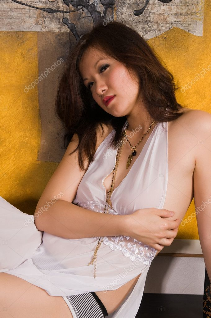 Pretty young Asian woman in a white nightgown  Stock Photo #4080983
