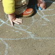 DRAWING LITTLE GIRL WITH A CHALK — Stock Photo