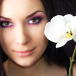 Brunette with orchid flower — Stock Photo #2826429