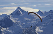 Winter paragliding in alps mountains — Stock Photo