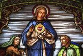 Stain glass depicting jesus christ — Stock Photo