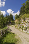 Gravel road in austrian alps — Stock Photo