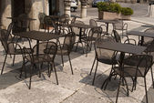 Metal chairs and table at bar restaurant — Stock Photo