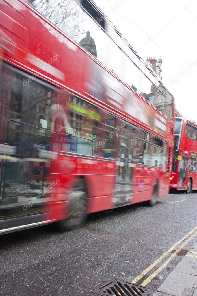Red london buses moving through the city at rush hour — Stock Photo #2825595