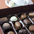 Chocolate truffles in a box — Stockfoto